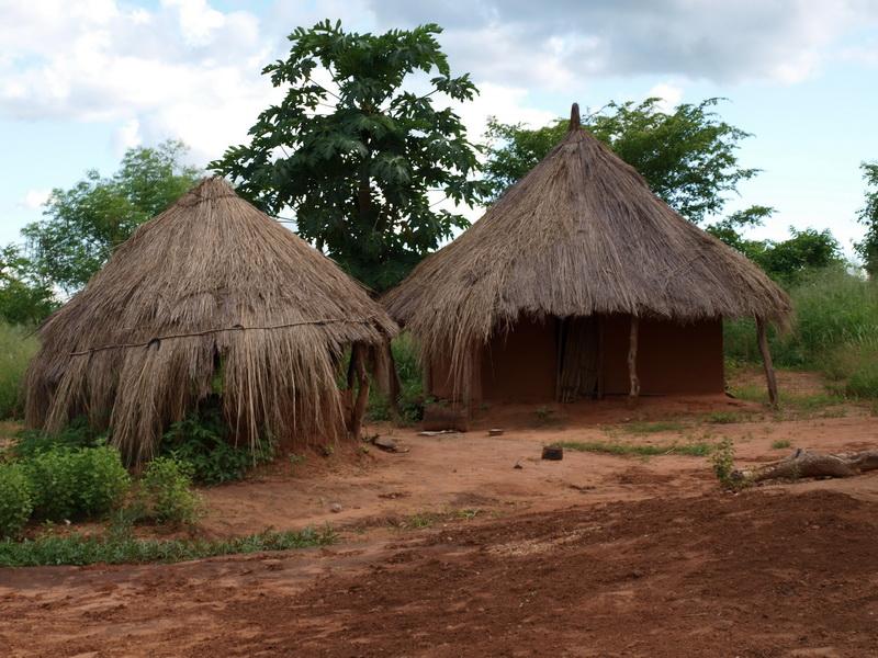 Kitchen and sleeping hut, Mr Capital\'s home in Chris\' Village, Kapululira